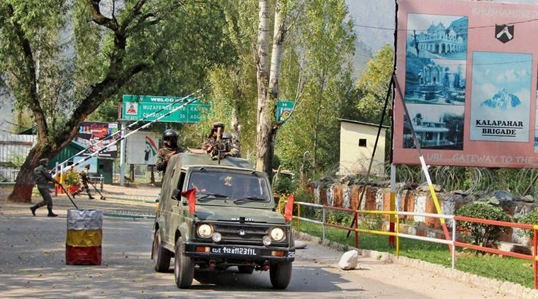 Uri: Army officers in a vehicle move inside the Uri Army Brigade Camp on Monday. PTI Photo (PTI9_19_2016_000179B)