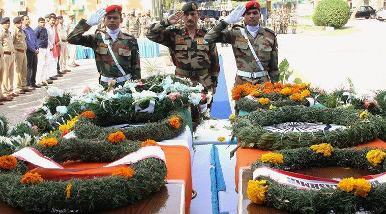 Jammu: An army officer paying tribute to the soldiers who were killed in Uri attack, at a wreath laying ceremony in Jammu on Monday. PTI Photo (PTI9_19_2016_000222B)