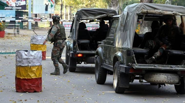 An army jawan take position near the Army base which was attacked by terrorists in Uri, west of Srinagar Sunday. Express Photo/Shuaib Masoodi