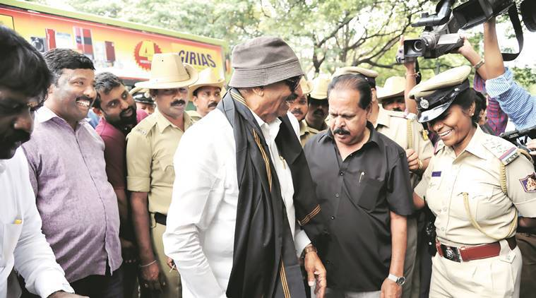 Vatal Nagraj , who is never seen without his floppy hat and dark glasses, after his arrest last week along with Sa Ra Govindu (centre). Mohan Kumar B N