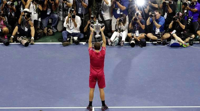 Stan Wawrinka, of Switzerland, holds up the championship trophy after beating Novak Djokovic, of Serbia, to win the men's singles final of the U.S. Open tennis tournament, Sunday, Sept. 11, 2016, in New York.(AP Photo/Seth Wenig)