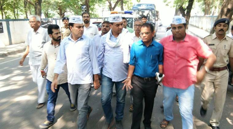 AAP MLA Gulabsingh Yadav and supporters walk towards the police station in Surat. Express Photo/Kamaal Saiyed