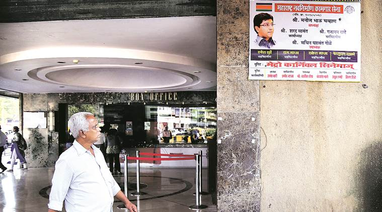 MNS workers replaced a poster of Ae Dil Hai Mushkil with their party union hoarding, at Metro Cinema Hall in South Mumbai on Thursday. Source: Nirmal Harindran