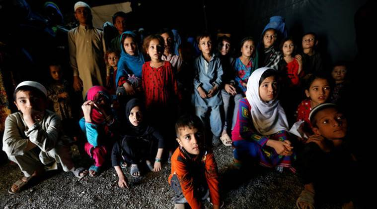 Afghan refugee children, returning from Pakistan, watch a short video clip about mines during a mines and explosives awareness program at a United Nations High Commissioner for Refugees (UNHCR) registration centre in Kabul, Afghanistan September 27, 2016. Picture taken September 27, 2016. REUTERS/Mohammad Ismail