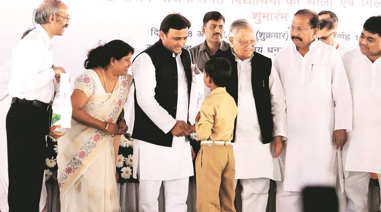 Akhilesh Yadav distributes utensils at a programme for school students in Lucknow on Friday. Pramod Adhikari