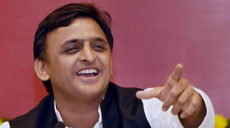 Lucknow: Uttar Pradesh Chief Minister Akhilesh Yadav addresses after distribution of ration cards under the National Food Security Act at CM residence in Lucknow on Wednesday. PTI Photo by Nand Kumar  (PTI10_19_2016_000081B)