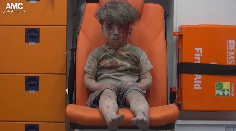 FILE- In this file frame grab taken from video on Wednesday, Aug. 17, 2016, which provided by the Syrian anti-government activist group Aleppo Media Center (AMC), 5-year-old Omran Daqneesh sits in an ambulance after being pulled out or a building hit by an airstirke, in Aleppo, Syria. Nearly 100 children were killed in a single week in Aleppo as Syrian and Russian warplanes sought to bombard into submission the rebel eastern districts of the city that have held out against Syrian government forces for five years. Without hope for the future, no regular schooling and little access to nutritious food, the children of Aleppo and their parents struggle to survive and fear the threat an imminent ground offensive.(Aleppo Media Center via AP, File)