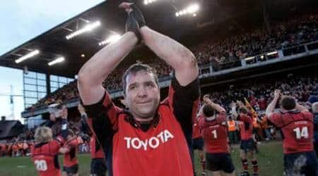 Munster's captain Foley applauds after defeating Perpignan in their Heineken Cup quarter-final rugby union match in Dublin