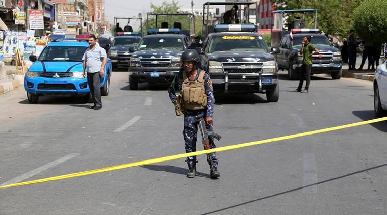 Iraqi security forces close the scene of a suicide bomb attack at a gathering of construction workers in the eastern New Baghdad neighborhood, Iraq, Tuesday, Sept. 27, 2016. Separate suicide bombings ripped through busy commercial areas in Shiite-dominated neighborhoods of the Iraqi capital on Tuesday, killing and wounding civilians, officials said. (AP Photo/Karim Kadim)