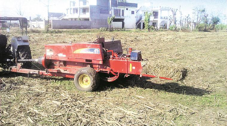 stubble, stubble paddy burning, pollution stubble pollution, health hazards, punjab government, punjab stubble burning, haryana stubble burning, baler, agriculture, use of baler, agriculture technology, indian express news, india news