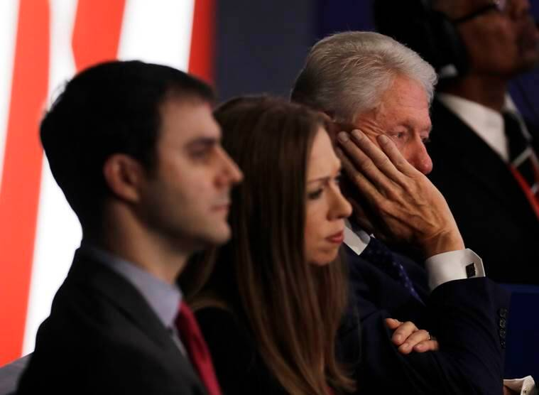 Bill Clinton and his daughter Chelsea listen to the second presidential debate between Republican presidential nominee Donald Trump and Democratic presidential nominee Hillary Clinton at Washington University in St. Louis, Sunday, Oct. 9, 2016. (AP Photo/Patrick Semansky)