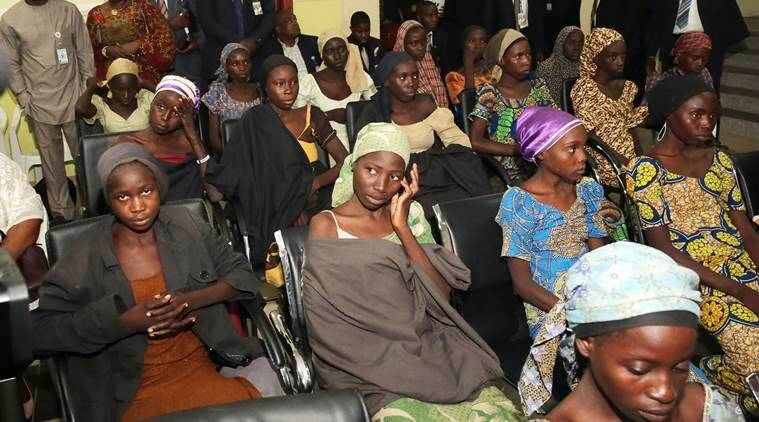 In this photo released by the Nigeria State House, freed Chibok school girls sit during a meeting with Nigeria Vice President Yemi Osinbajo, in Abuja,, Nigeria, Thursday, Oct. 13, 2016. Twenty-one of the Chibok schoolgirls kidnapped by Boko Haram more than two years ago were freed Thursday in a swap for detained leaders of the Islamic extremist group — the first release since nearly 300 girls were taken captive in a case that provoked international outrage. (Sunday Aghaeze/Nigeria State House via AP)