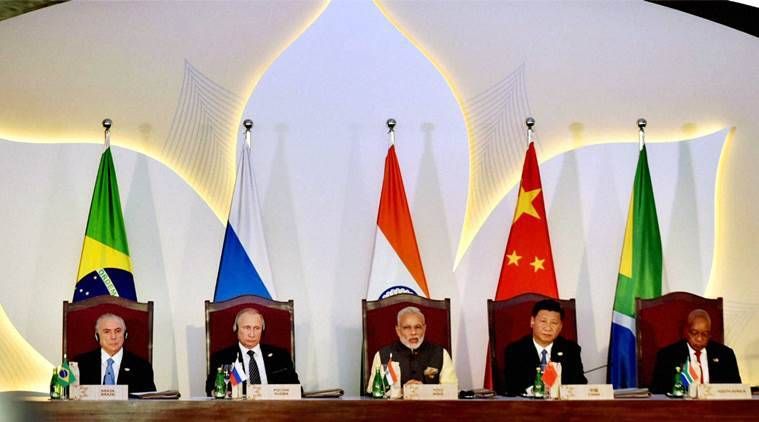 Benaulim: Prime Minister Narendra Modi with, left to right, Brazilian President Michel Temer, Russian President Vladimir Putin, Chinese President Xi Jinping and South African President Jacob Zuma addressing the BRICS Business Council meeting during BRICS Summit in Benaulim, Goa on Sunday. PTI Photo / PIB (PTI10_16_2016_000129A) *** Local Caption ***