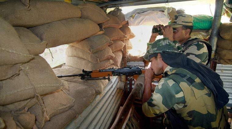 BSF on alert at a checkpost at International Border in RS Pura Sector in Jammu on Wednesday. (PTI Photo)