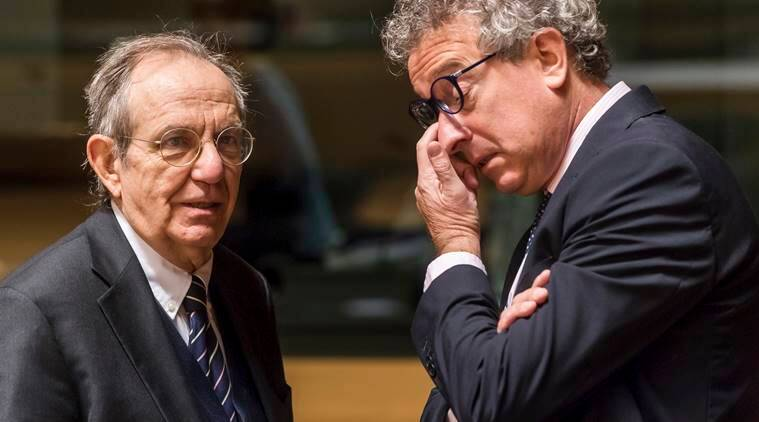 Italy's Finance Minister Pier Carlo Padoan, left, talks with Luxembourg's Finance Minister Pierre Gramegna during an EU finance ministers meeting at the EU Council in Luxembourg on Tuesday, Oct. 11, 2016. (AP Photo/Geert Vanden Wijngaert)