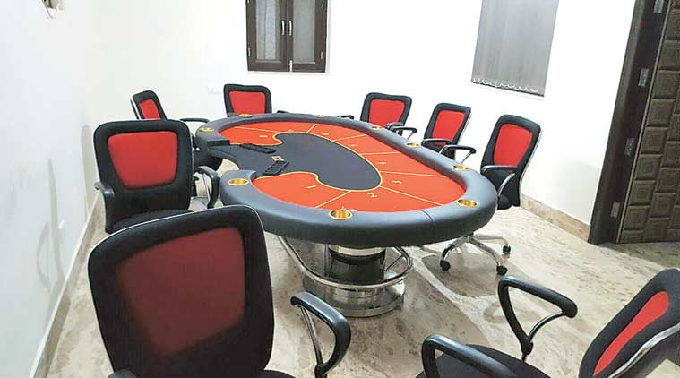 Three large Casino tables, stake money of Rs 43,500 and 2,968 gambling tokens worth crores were recovered. (Express Photo)