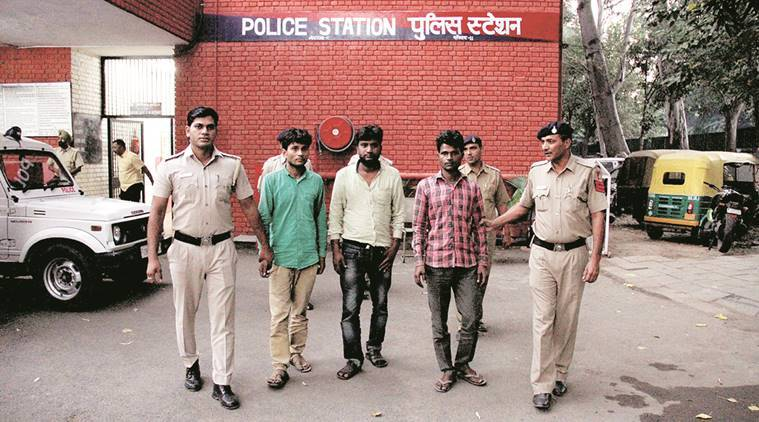 The accused at Sec 11 police station in Chandigarh Tuesday.  (Express Photo)