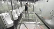 Try at your own risk: An ecological park in China opens glass toilets for visitors