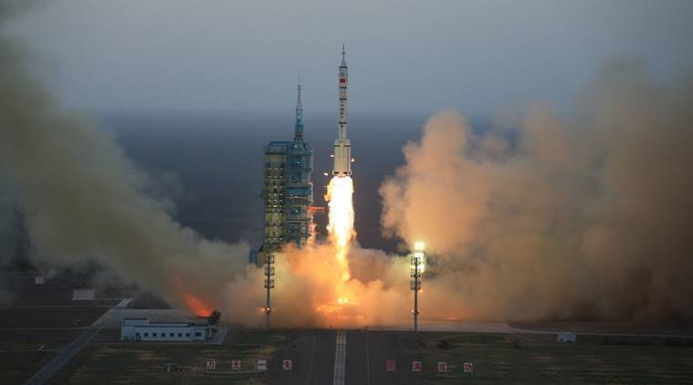 In this photo provided by China's Xinhua News Agency, the Long March-2F carrier rocket carrying China's Shenzhou 11 spacecraft blasts off from the launch pad at the Jiuquan Satellite Launch Center in Jiuquan, northwest China's Gansu Province, Monday, Oct. 17, 2016. China has launched a pair of astronauts into space on a mission to dock with an experimental space station and remain aboard for 30 days. (Li Gang/Xinhua via AP)