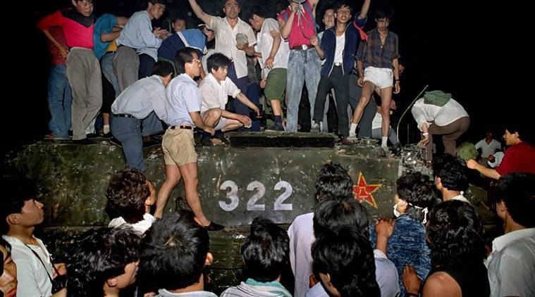 FILE - In this early June 4, 1989 file photo, civilians with rocks stand on a government armored vehicle near Chang'an Boulevard in Beijing as violence escalated between pro-democracy protesters and Chinese troops, leaving hundreds dead overnight. China's last-known prisoner held in relation to the 1989 Tiananmen Square protests will reportedly be released Saturday, Oct. 15, 2016 but he'll face freedom a frail and mentally ill man, a rights group and a fellow former inmate said. Miao Deshun's expected release follows an 11-month sentence reduction, according to the Dui Hua Foundation, a San Francisco-based group that advocates for the rights of political prisoners in China. (AP Photo/Jeff Widener, File)