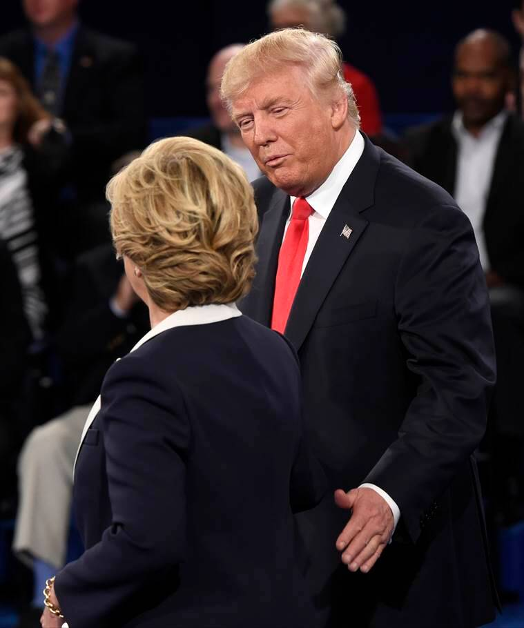 Republican presidential nominee Donald Trump and Democratic presidential nominee Hillary Clinton shake hands after the second presidential debate at Washington University in St. Louis, Sunday, Oct. 9, 2016. (Saul Loeb/Pool via AP)
