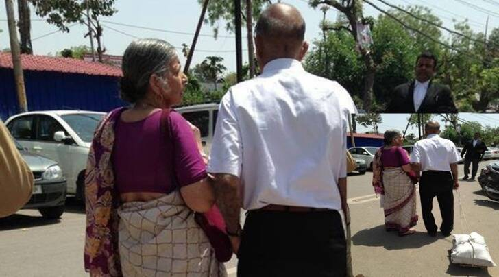 elderly goes to court with a pile of files, elderly couple goes drags case files around, facebook post elderly couple denied justice, indian express, indian express news, trending