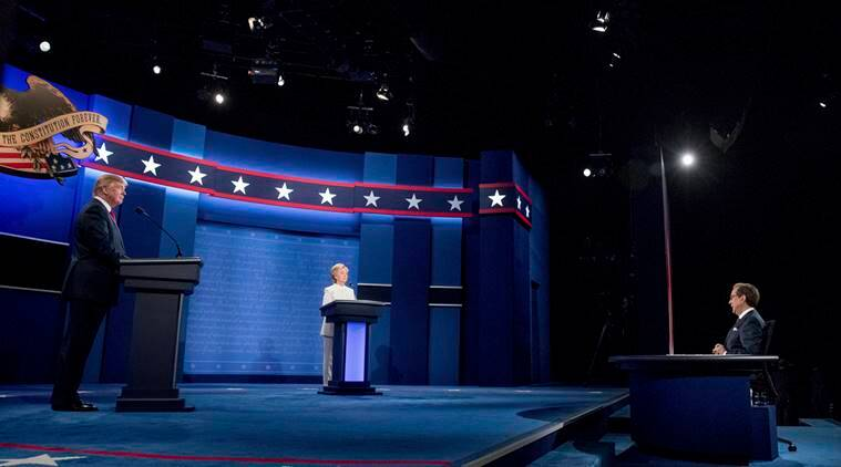 Democratic presidential candidate Hillary Clinton, center, and Republican presidential candidate Donald Trump, left, take the stage for the third presidential debate at University of Nevada in Las Vegas, N.Y., Wednesday, Oct. 19, 2016. Also pictured is moderator Chris Wallace, right. (AP Photo/Andrew Harnik)
