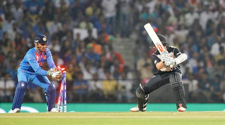 Cricket - New Zealand v India - World Twenty20 cricket tournament - Nagpur, India, 15/03/2016. India's captain and wicketkeeper Mahendra Singh Dhoni (L) stumps New Zealand's captain Kane Williamson. REUTERS/Danish Siddiqui