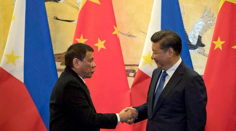 Beijing : Philippine President Rodrigo Duterte, left, and Chinese President Xi Jinping shake hands after a signing ceremony in Beijing, China, Thursday, Oct. 20, 2016. Duterte was meeting Thursday with Xi in Beijing as part of a charm offensive aimed at seeking trade and support from the Asian giant by setting aside a thorny territorial dispute. AP/PTI(AP10_20_2016_000045B)