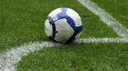 A soccer ball is rests on the pitch during the English Premier League soccer match between Burnley and Everton in Burnle