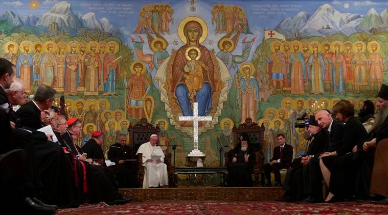 Pope Francis reads a speech during his meeting with Georgian Orthodox Patriarch Iliya II, center right, in Tbilisi, Georgia, on Friday, Sept. 30, 2016. The pontiff is traveling to Georgia and Azerbaijan for a three-day visit. (AP Photo/Ivan Sekretarev)