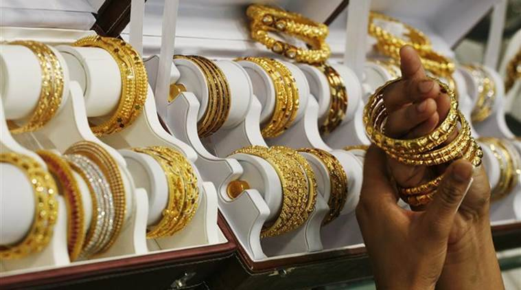 Gold, Gold prices, gold prices fall, gold prices go down, gold falls, india market, india buisness, business news, indian express