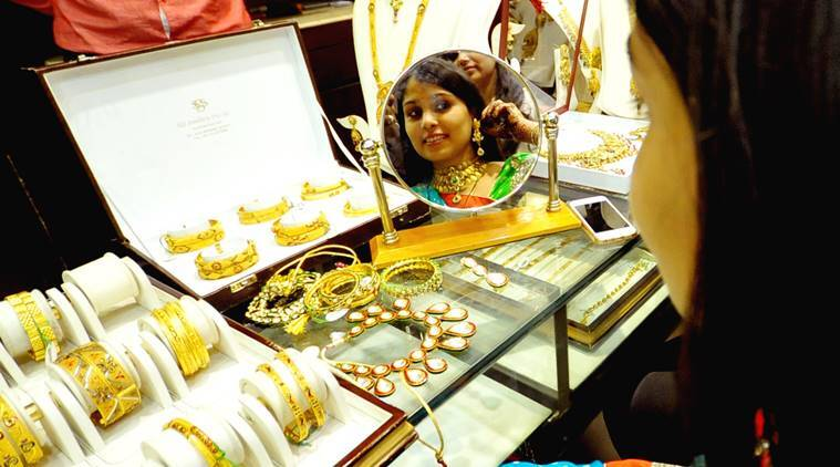 A Woman with gold ornaments at a jewellery shop on the occasion of Dhanteras in Jaipur on Monday. Express Photo by Rohit Jain Paras. 09.11.2015.