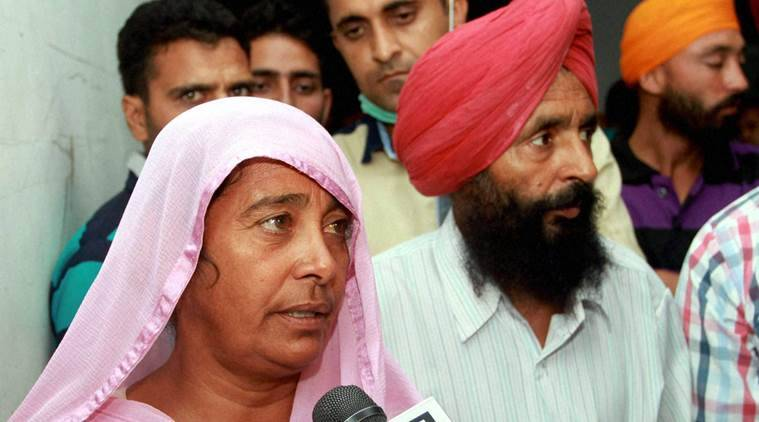 Jammu: Parents of BSF jawan Gurnam Singh talk with media persons, Yesterday who got head injury by sniper shot from Pakistan side at Bobiya Border post at Hiranagar near international border, in Kathua district at Government Medical collage, in Jammu, on Saturday. PTI Photo (PTI10_22_2016_000199B)