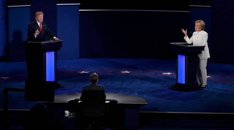 Republican U.S. presidential nominee Donald Trump and Democratic U.S. presidential nominee Hillary Clinton take part in their third and final 2016 presidential campaign debate, moderated by Chris Wallace (C), at UNLV in Las Vegas, Nevada, U.S., October 19, 2016. REUTERS/David Becker