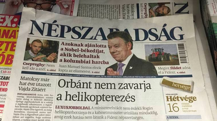 "A newsstand including Saturday papers with Nepszabadsag daily is pictured in Budapest, Saturday, Oct. 8, 2016. Headline of Nepszabadsag reads: ""Orban not bothered by helicoptering"". It refers to a scandal uncovered by Nepszabadsag about the extravagant travel habits of a top minister in the government of Prime Minister Viktor Orban. (AP Photo/Andras Nagy)"