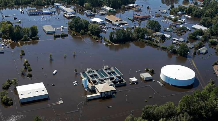 The water treatment plant is flooded from rain due to Hurricane Matthew in Lumberton, N.C., Wednesday, Oct. 12, 2016. People were ordered to evacuate, and officials warned that some communities could be cut off by washed out roads or bridge closures. (AP Photo/Chuck Burton)