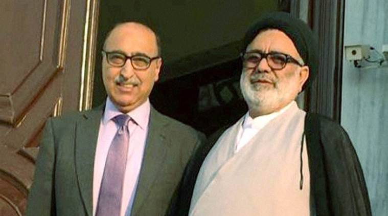 New Delhi: Pakistan High Commissioner to India Abdul Basit with Hurriyat leader Agha Syed Hassan AL-Moosvi during a meeting in New Delhi on Tuesday. PTI Photo(STORY DEL60) (PTI10_18_2016_000301B)