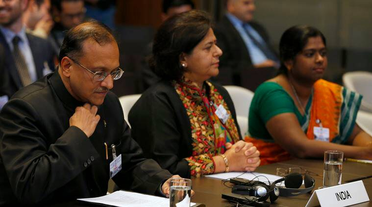 India's delegation with Ambassador J.S. Mukul, left, Kajal Bat, the embassy's first secretary, center, and Asha Antony, the embassy's second secretary, right, wait for the start of the World court session in The Hague, Netherlands, Wednesday, Oct. 5, 2016, where the Marshall Island are taking India, Pakistan and the U.K. to court to urge those powers to resume negotiations to eradicate the world's nuclear stockpile. (AP Photo/Peter Dejong)