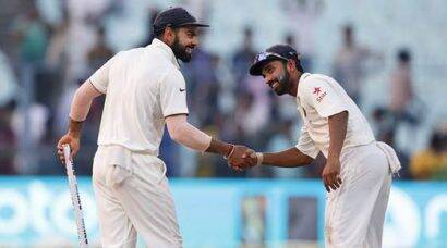 Indian cricket team captain Virat Kohli, left, and teammate Ajinkya Rahane congratulate each other as India wins against New Zealand on the fourth day of the second cricket test match in Kolkata, India, Monday, Oct. 3, 2016. (AP Photo/Saurabh Das)