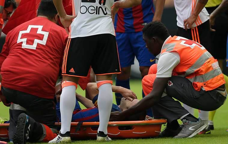 FC Barcelona's Andes Iniesta lies on a stretcher on the pitch after an injury during the Spanish La Liga soccer match between Valencia and FC Barcelona at the Mestalla stadium in Valencia, Spain, Saturday, Oct. 22, 2016. (AP Photo/Manu Fernandez)
