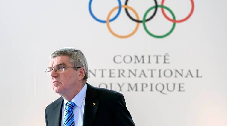 International Olympic Committee President Thomas Bach arrives for the opening of an Olympic Summit, Saturday, Oct. 8, 2016 in Lausanne, Switzerland. Olympic sports leaders have begun debating how to improve a global anti-doping system amid the fallout of a Russian state-backed cheating scandal. (Fabrice Coffrini/Pool Photo via AP)