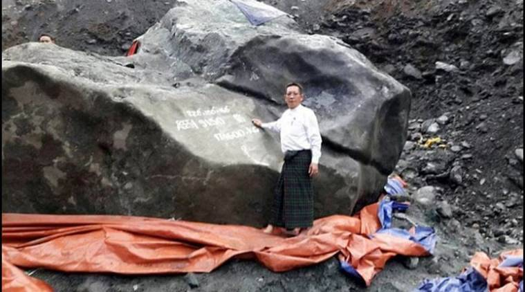 U Tint Soe with the discovered jade stone in Myanmar.