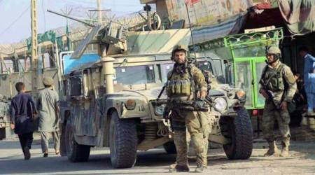 Afghan forces battle to retake district from Taliban