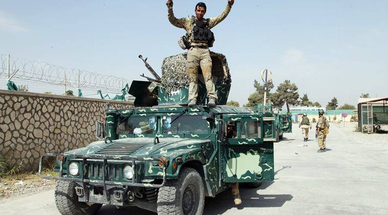 "ADDITION-- ADDS DATE OF ANNOUNCEMENT. FILE -- In this Oct. 2, 2015 file photo, an Afghan soldier raises his hands as a victory sign, in Kunduz city, north of Kabul, Afghanistan. Afghan officials said Tuesday, Oct. 4, 2016, that fierce gunbattles are underway for a second day across the embattled northern city of Kunduz after the Taliban launched a new, multipronged attack on the city they briefly captured last year. Interior Ministry spokesman Sediq Sediqqi says Afghan security forces are ""trying to secure the city"" but that Taliban gunmen are hiding in residential homes, making progress slow and difficult. (AP Photo/Dehsabzi, File)"