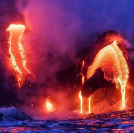 Photographer risks his life to capture stunning shots of volcano in the Pacific Ocean