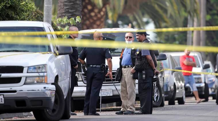 Los Angeles police investigators work the scene of a fatal shooting in the Crenshaw District neighborhood of Los Angeles, Saturday, Oct. 15, 2016.  According to police an early morning argument at a restaurant triggered gunfire.  (AP Photo/Reed Saxon)