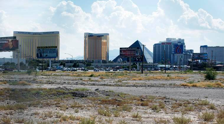 FILE - In this July 1, 2016, file photo, a vacant lot that is the site of a proposed football stadium sits near McCarran International Airport in Las Vegas. Nevada lawmakers convene Monday, Oct. 10, 2016, to consider raising taxes in the Las Vegas area to help fund a .9 billion football stadium, a .4 billion convention center expansion and more police officers to protect the additional tourists. (AP Photo/John Locher, File)