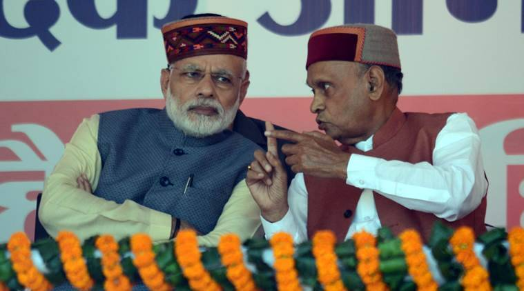 Prime Minister Narendra Modi with former Chief Minister Prem Kumar Dhumal Modi during a parivartan rally in Mandi on Tuesday. Express photo by Lalit Kumar. 18.10.2016.