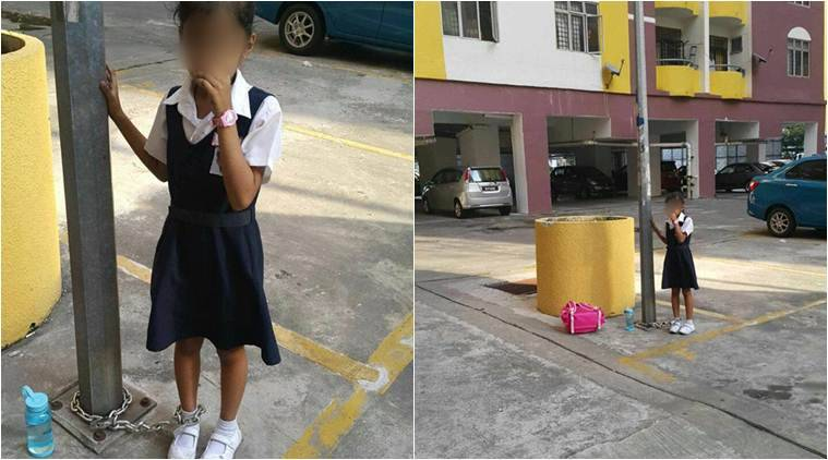 mother chained girl, malaysia mother chained girl, girl chained to lamp post, girl chained to lamp post photos, parents children punishment, child assault, viral news, malaysia news, latest news, indian express